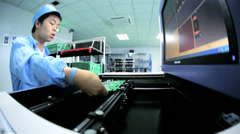 Precision quality control checks Chinese worker PCBs, China Stock Footage