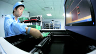 Stock Video Footage of Precision quality control checks Chinese worker PCBs, China