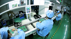Factory assembly line production of PCBs, Mainland China - stock footage