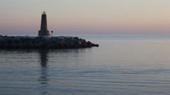 Marbella Marina Spit Lighthouse Timelapse at dawn Stock Footage