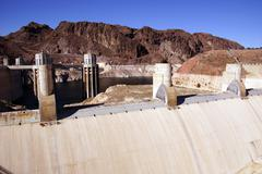 towers and turbines on  hoover dam - stock photo