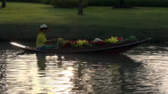 Stock Video Footage of Rama ix park festival 2013 - Flower seller in boat (42-1)