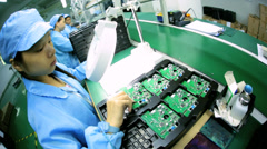 Female Chinese worker checking PCBs, Mainland China - stock footage