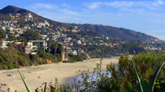 Laguna Beach Hillside Homes And Sandy Aliso Beach Coastline Stock Footage