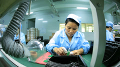 Motion view Chinese workers manufacturing PCBs, China - stock footage