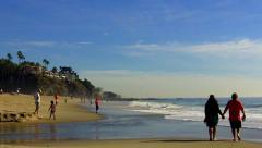 Middle Aged Couple Walk On Aliso Beach- Laguna Beach CA Stock Footage