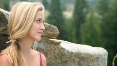 Pretty Teen Girl Serene and Smiling, Glances At Camera, In A Natural Setting Stock Footage