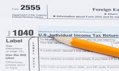 Tax forms 1040 and 2555 Stock Photos
