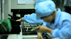 Assembly line technology Chinese worker producing PCBs, China - stock footage