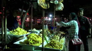 Stock Video Footage of Rama ix park festival 2013 - Buying fruit (30)