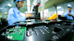 Technology female Chinese worker producing PCBs, China Stock Footage