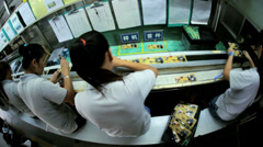 Wide angle motion view Chinese workers manufacturing PCBs, China - stock footage