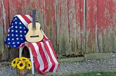 Guitar on American flag Stock Photos