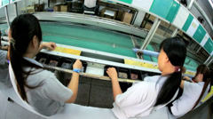 Motion view Chinese workers manufacturing PCBs, China, Time lapse - stock footage