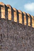 Fortified wall of an ancient castle Stock Photos
