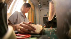 Female Chinese factory  worker operating industrial machine, China - stock footage
