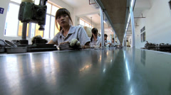 Chinese workers factory assembly line, Mainland China - stock footage