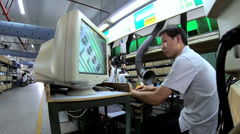 Precision quality control checks Chinese worker PCBs, China - stock footage