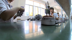 Chinese workers factory assembly line, China, Time lapse - stock footage