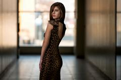 model wearing a dress with animal print - stock photo