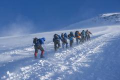 A group of alpinists on their way to the elbrus Stock Photos