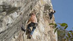 Rock climber on steep rock wall HD Stock Footage