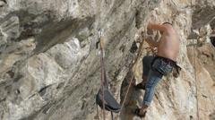 Rock climber on limestone wall HD Stock Footage