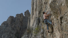 rock climber lunges for handhold HD - stock footage