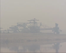 Industrial heritage, excavators brown coal mine in mist + zoom out lake Gremmin Stock Footage