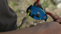 Rock climbing close up belay device HD Stock Footage