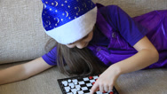 Stock Video Footage of Young girl playing checkers. The intellect. The mind.