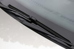 Close up of windscreen wipers in resting position on windshield Stock Photos