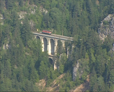 Locomotive on Semmering railway bridge Kalte Rinne Viaduct and Polleros tunnel Stock Footage