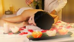 Woman receiving massage in dream atmosphere - stock footage