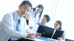 Asian Chinese Medical Consultants Boardroom Planning Meeting - stock footage