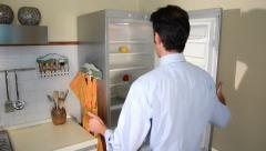 Stock Video Footage of hungry man looking for food in empty refrigerator