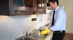 Businessman washing dishes Stock Footage