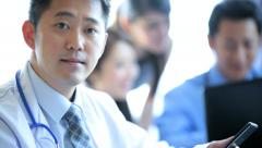 Close Up Asian Chinese Consultant Hospital  Colleagues Background - stock footage