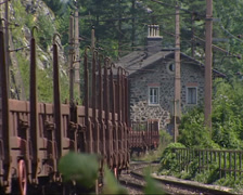 Freight wagons running on winding railway track, part of Semmering Railway Stock Footage