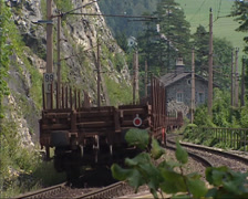Freight wagons running on winding railway track in the Austrian Alps Stock Footage