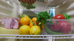 Housewife takes out vegetables from the fridge Stock Footage