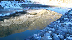 Floe floating on the river, illuminated by golden sun - stock footage