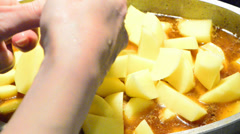 Cutting potato Stock Footage