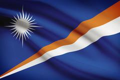 marshallese flag blowing in the wind. part of a series. - stock illustration