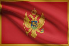montenegrin flag blowing in the wind. part of a series. - stock illustration