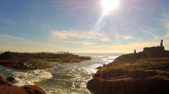 People Watching Seabirds Flocking On Rocky Island- Laguna Beach CA Stock Footage