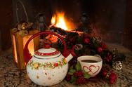 Stock Photo of tea time in front of the fireplace