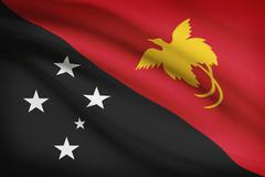 papua new guinean flag blowing in the wind. part of a series. - stock illustration