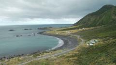 Pan across rugged New Zealand coastline Stock Footage