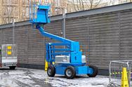 Stock Photo of articulating boom lift